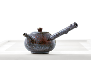 Flat Round Teapot With Mottled Maroon Glaze